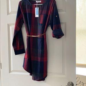 Plaid dress with belt.